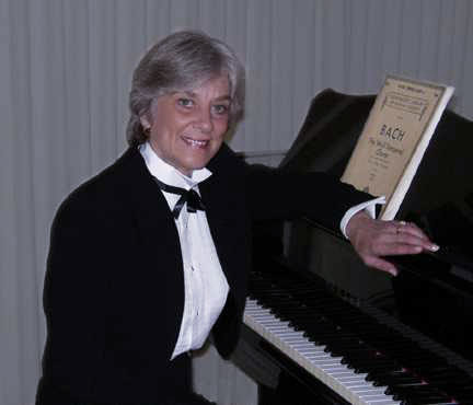 Patricia Long, composer, at the piano